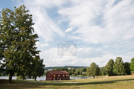 red house near lake under cloudy sky, Hamar, Hedmark, Norway