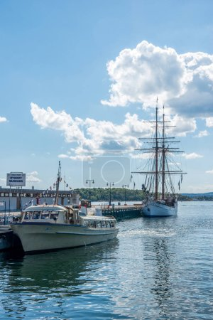 Photo for OSLO, NORWAY - 28 JULY, 2018: boats moored in harbour at Aker Brygge district, Oslo - Royalty Free Image