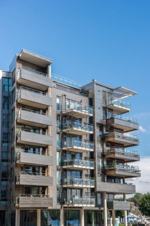 OSLO, NORWAY - 28 JULY, 2018: modern building with balconies at sunny day, Aker Brygge district, Oslo, Norway