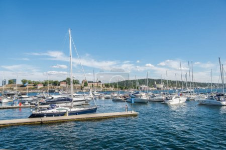 Photo for OSLO, NORWAY - 28 JULY, 2018: boats and yachts in harbour, Aker Brygge district, Oslo - Royalty Free Image