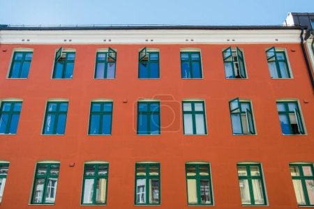 Photo for Low angle view of bright red house at sunny day in oslo, norway - Royalty Free Image