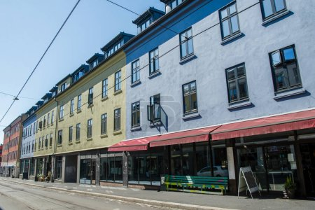 beautiful bright buildings and empty street at sunny day, oslo, norway