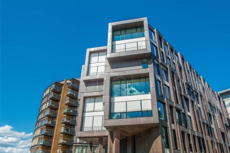 Photo for Low angle view of beautiful modern houses against blue sky at Aker Brygge district, Oslo - Royalty Free Image