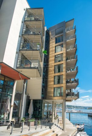 contemporary architecture and embankment at Aker Brygge district, Oslo, Norway