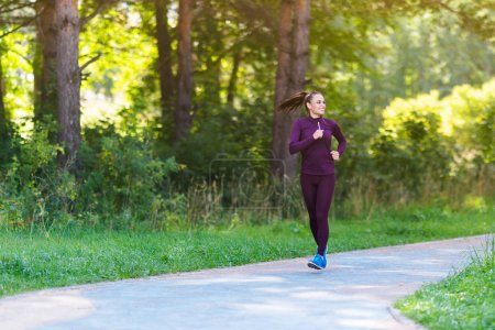 Running woman. Female runner jogging outdoors in the park. Fitness, sport and weight loss concept