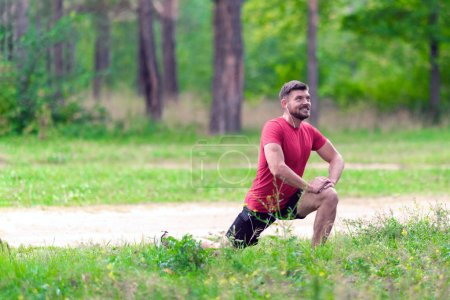 Photo for Athletic man runner stretching legs before run. Healthy, fitness, wellness lifestyle. Sport, cardio, workout concept - Royalty Free Image
