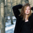 Young sexy woman in black clothes,with red hair, l...