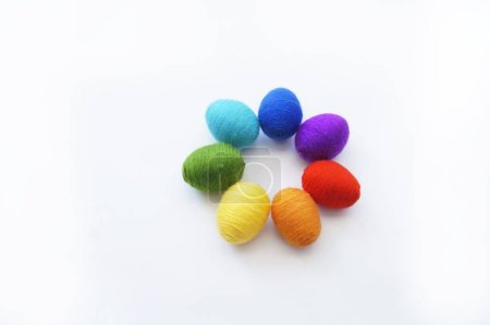 Easter eggs knitted from wool. Manual work. Rainbo...