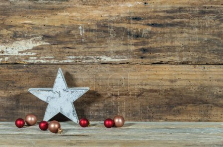 Photo for Christmas wood background with star shape and baubles decoration - Royalty Free Image