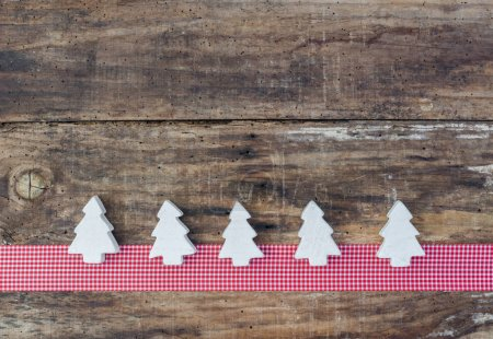 Photo for Christmas tree ornaments on red ribbon border decoration and rustic wooden background, copyspace - Royalty Free Image