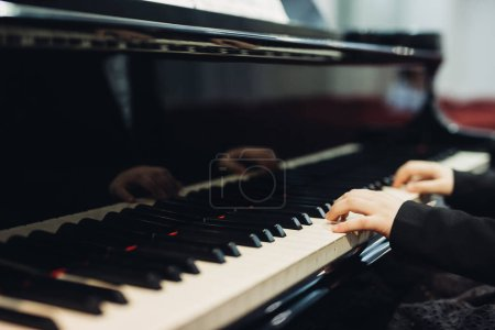 Photo for Close up little girl playing piano - Royalty Free Image