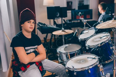 Photo for Boy drummer crossed arms in music studio - Royalty Free Image
