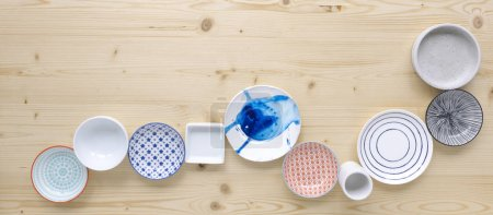 Photo for Collection modern colorful and white crockery on light wood background - Royalty Free Image