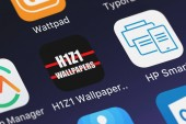 London, United Kingdom - September 29, 2018: The H1Z1 Wallpapers mobile app from Matthew Nelsen on an iPhone screen.