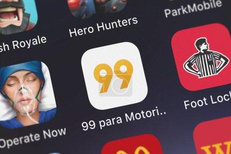 London, United Kingdom - October 01, 2018: Icon of the mobile app 99 para Motorista from 99 Taxis Desenvolvimento de Softwares Ltda. - Epp on an iPhone.
