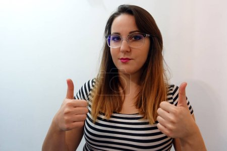 Photo for Isolated Female showing Thumbs up - Royalty Free Image