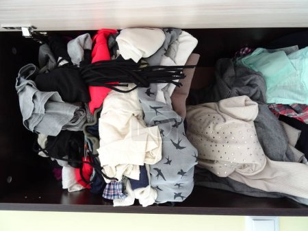 Photo for Wardrobe with Messy Girl Clothes - Royalty Free Image