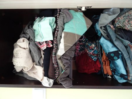Photo for Wardrobe with Messy Woman Clothes - Royalty Free Image