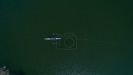 Aerial shot rowing team on  water, top view