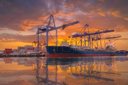 Logistics and transportation of Container Cargo ship and Cargo plane with working crane bridge in shipyard at Twilight sky, logistic import export background and transport industry.