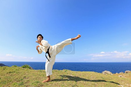One karate kata training man...