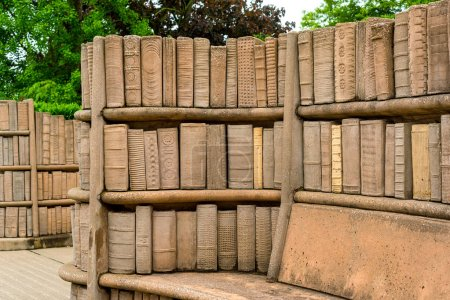 Outdoor stone benches, with shelves full of old books carved in stone, on the campus of Kent State University in Northeast Ohio.
