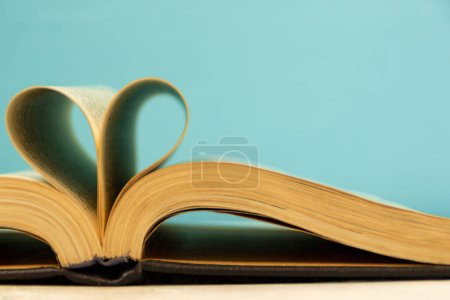 The pages of the book are curved in the shape of a...