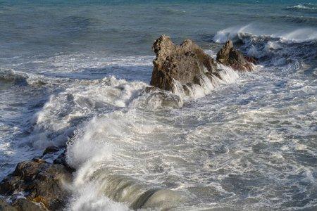 Photo for Stormy waves crashing on rocky beach called Galeazza, Province of Imperia, Liguria, northwestern Italy - Royalty Free Image