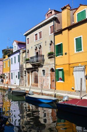 BURANO, ITALY - JUNE 10,2016: Colorful Houses and Canals with Boats  in Burano Island near Venice, Italy
