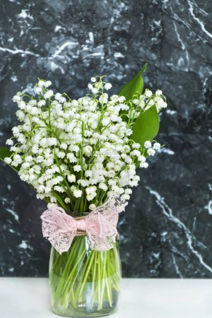 Lily of the Valley Bouquet in  Vase .Spring Flowers Background