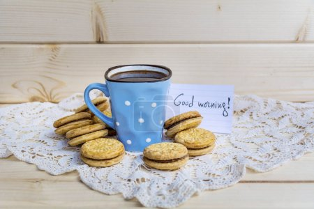 Photo for Blue mug of tea and oatmeal cookies on wooden background - Royalty Free Image