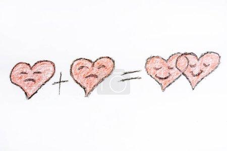 Foto de El corazón triste más el corazón triste equivale a dos corazones sonrientes. - Imagen libre de derechos