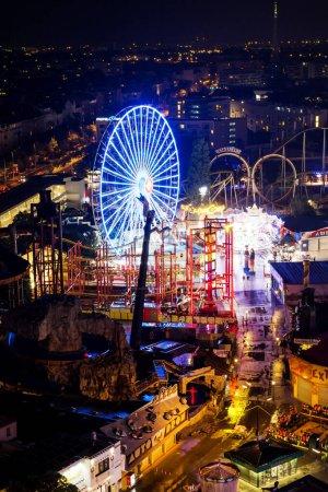 Photo for Vienna, Austria - 10 July 2019 - The Wurstelprater Amusement Park at Night .Blumenrad, Ferris Wheel in the Prater - Royalty Free Image