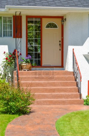Entrance of family house with doorsteps and pathwa...