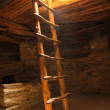 Wooden ladder and rooftop opening inside an underg...