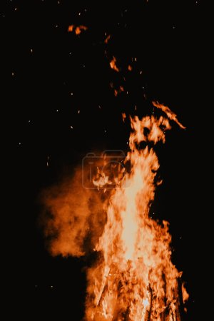 beautiful hot burning tall flames from bonfire on dark background