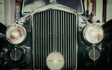 Photo for Front view of classic vintage car. Retro toned postcard, poster. - Royalty Free Image
