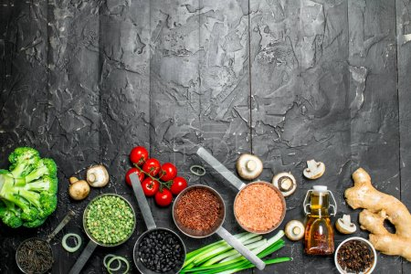 Photo for Organic food. Different healthy vegetables and fruits with beans. On a black rustic background. - Royalty Free Image