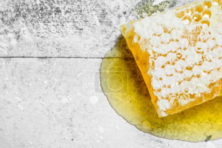 Photo for Natural honey in honeycombs. On a rustic background. - Royalty Free Image