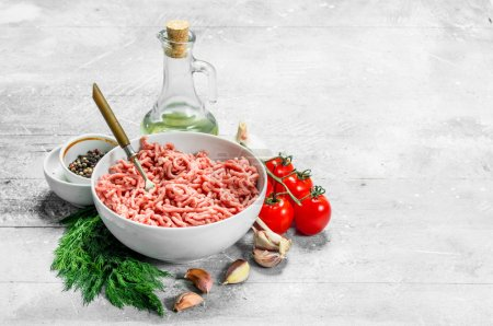 Photo for Raw minced beef with spices and herbs . On a rustic background. - Royalty Free Image
