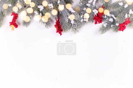 Photo for Festive winter holidays composition with fir tree branches and christmas decorations - Royalty Free Image