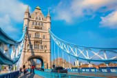 Tower Bridge that crosses River Thames in London, UK London, UK - May 14 2018: Tower bridge crosses the River Thames, it's built in 1886 consists of two bridge towers, the bridge deck is freely accessible to both vehicles and pedestrians