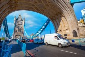 London, UK - May 14 2018: Tower bridge crosses the River Thames, it's built in 1886 consists of two bridge towers, the bridge deck is freely accessible to both vehicles and pedestrians