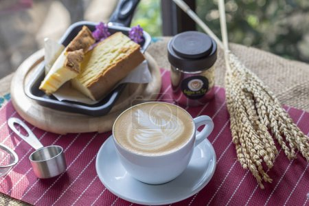 Photo for Slices of biscuit on table with coffee - Royalty Free Image