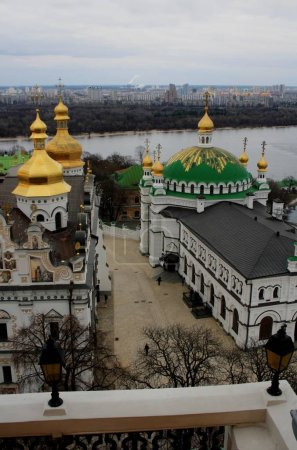 Kiev Pechersk Lavra on hill of Dnieper river with city on background