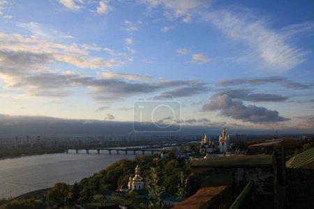 Kiev Pechersk Lavra on hill of Dnieper river on background