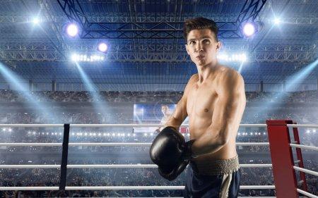 Photo pour Deux boxeurs se battent sur un ring professionnel . - image libre de droit