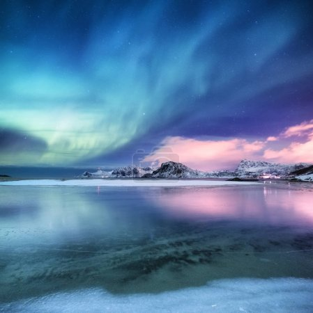 Photo for Aurora borealis on the Lofoten islands, Norway. Green northern lights above ocean. Night sky with polar lights. Night winter landscape with aurora and reflection on the water surface. Norway-image - Royalty Free Image