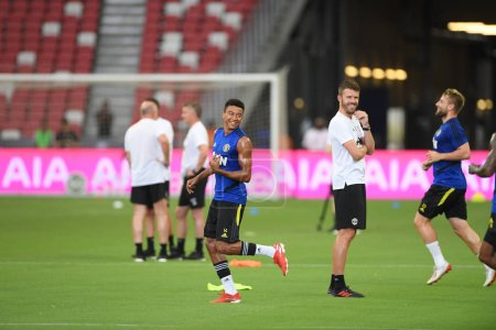 Photo for Kallang-singapore-19jul2019:Jesse lingard #14 player of manchester united in action during official training before icc2019 at national stadium,singapore - Royalty Free Image