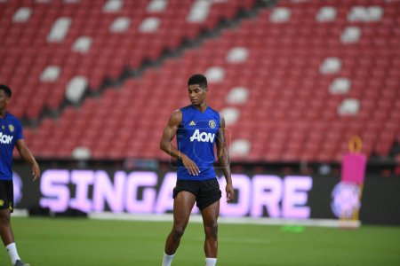 Photo for Kallang-singapore-19jul2019:Marcus rashford #10 player of manchester united in action during official training before icc2019 at national stadium,singapore - Royalty Free Image